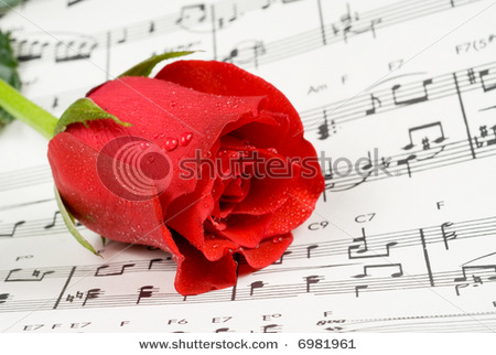 275262-yellow-and-red-rose-on-top-of-music-notes2